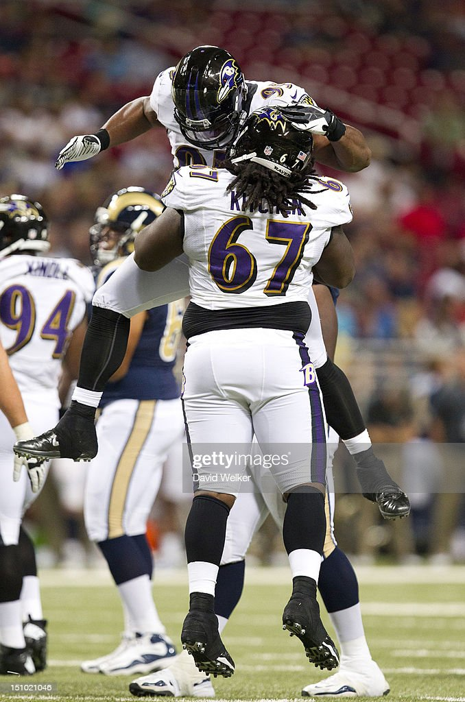 Guard Ishmaa'ily Kitchen #67 and defensive tackle Bryan Hall #95 of the Baltimore Ravens celebrate after making a tackle during the game against the St. Louis Rams at the Edward Jones Dome on August 30, 2012 in St. Louis, Missouri. The St. Louis Rams defeated the Baltimore Ravens 31-17.