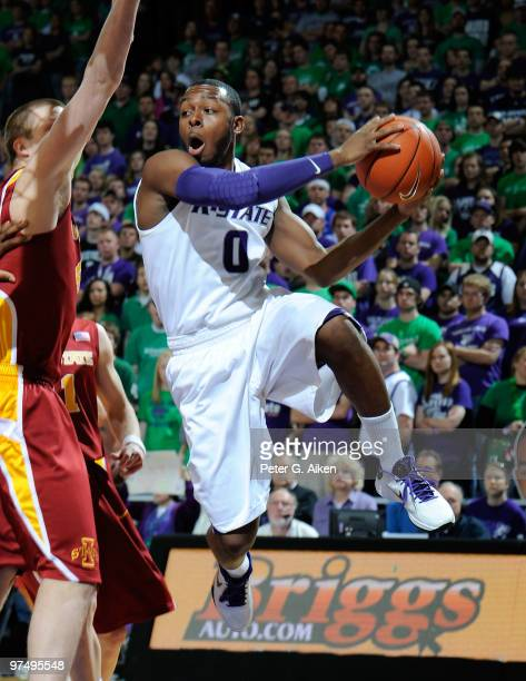 Guard Jacob Pullen of the Kansas State Wildcats drives around pressure towards the basket in the first half against the Iowa State Cyclones on March...