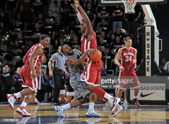 Guard Jacob Pullen of the Kansas State Wildcats runs into forward Andrew Fitzgerald of the Oklahoma Sooners during the first half on February 19 2011...