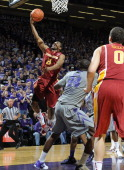 Guard Jake Anderson of the Iowa State Cyclones drives to the basket past forward Curtis Kelly of the Kansas State Wildcats during the first half on...