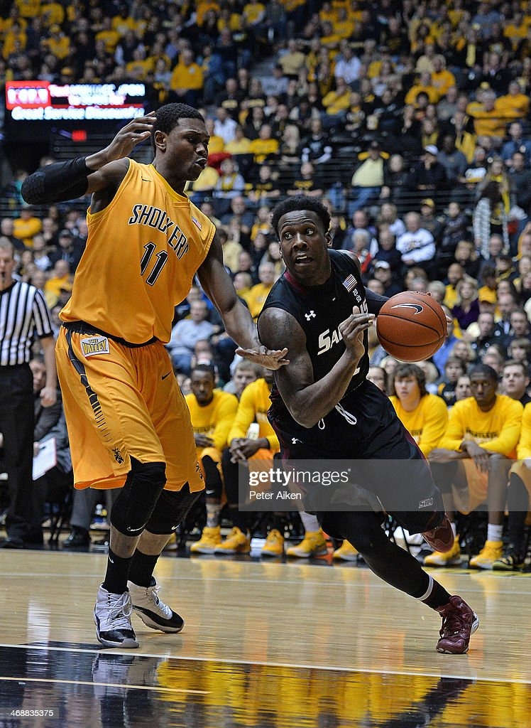 Guard Jalen Pendleton #1 of the Southern Illinois Salukis drives past forward <a gi-track='captionPersonalityLinkClicked' href=/galleries/search?phrase=Cleanthony+Early&family=editorial&specificpeople=10064686 ng-click='$event.stopPropagation()'>Cleanthony Early</a> #11 of the Wichita State Shockers during the first half on February 11, 2014 at Charles Koch Arena in Wichita, Kansas. Wichita State won 78-67.