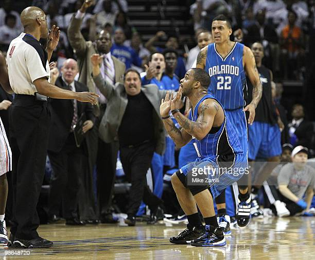 Guard Jameer Nelson of the Orlando Magic pleads with referee Leon Wood after he made a three point shot during the game between the Charlotte Bobcats...