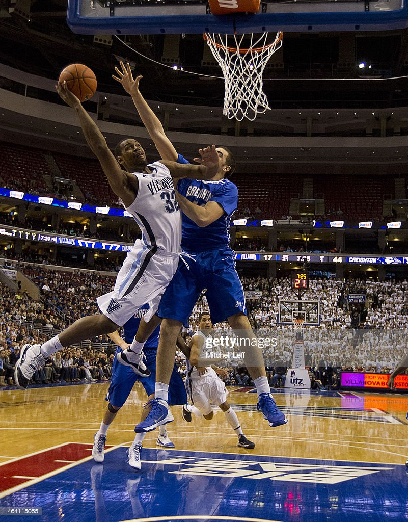 Guard James Bell of the Villanova Wildcats attempts a layup against the Creighton Bluejays on January 20 2014 at the Wells Fargo Center in...