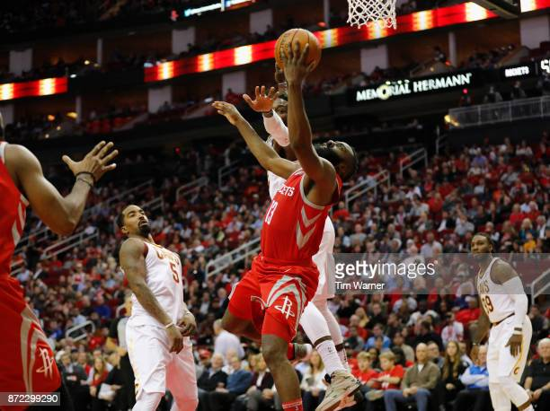 Guard James Harden of the Houston Rockets drives to the basket defended by forward Jeff Green of the Cleveland Cavaliers in the first half at Toyota...
