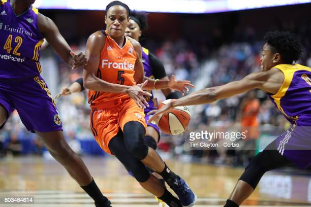 Guard Jasmine Thomas of the Connecticut Sun has the ball stripped by Alana Beard of the Los Angeles Sparks during the Los Angeles Sparks Vs...
