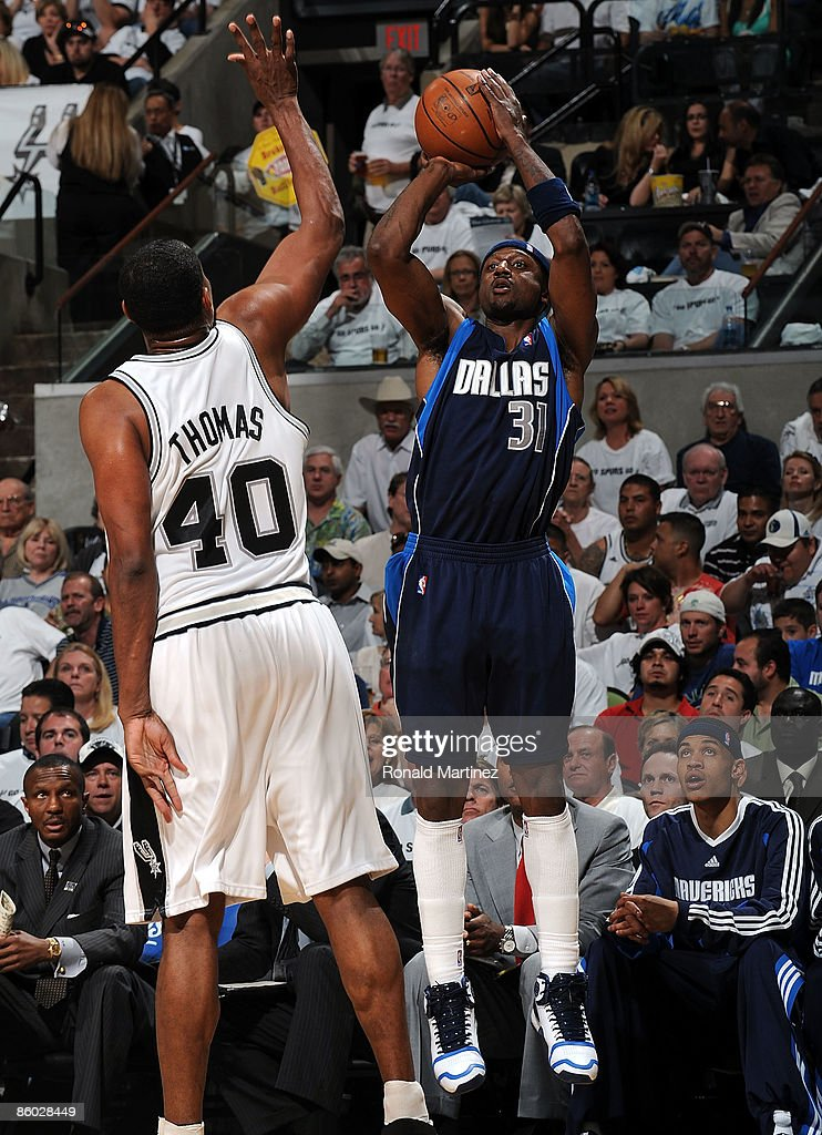 Guard Jason Terry #31 of the Dallas Mavericks takes a shot against Kurt Thomas #40 of the San Antonio Spurs in Game One of the Western Conference Quarterfinals during the 2009 NBA Playoffs at AT&T Center on April 18, 2009 in San Antonio, Texas.