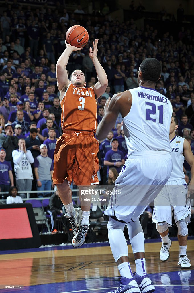 Guard Javan Felix #3 of the Texas Longhorns drives to the basket against forward Jordan Henriquez #21 of the Kansas State Wildcats during the first half on January 30, 2013 at Bramlage Coliseum in Manhattan, Kansas.