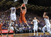 Guard Javan Felix of the Texas Longhorns drives to the basket against guard Omari Lawrence of the Kansas State Wildcats during the first half on...