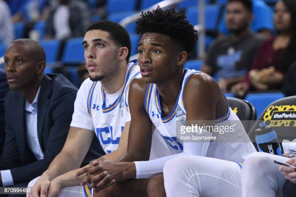 UCLA guard Jaylen Hands sits on the bench next to UCLA guard LiAngelo Ball during an college exhibition basketball game between the Cal State Los...