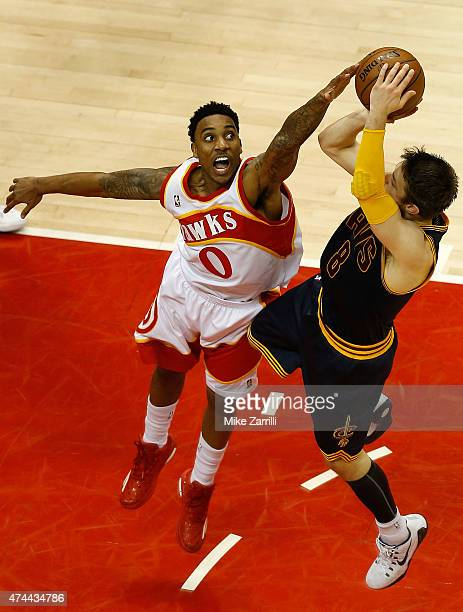 Guard Jeff Teague of the Atlanta Hawks blocks a shot from guard Matthew Dellavedova of the Cleveland Cavaliers during the 2015 NBA Playoffs at...