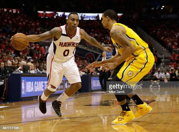 Guard Jeff Teague of the Atlanta Hawks dribbles against guard George Hill of the Indiana Pacers in Game 6 of the Eastern Conference Quarterfinals...