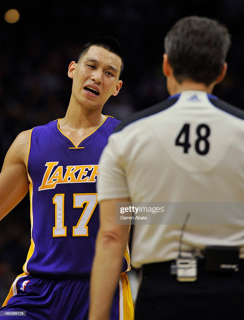 Guard Jeremy Lin of the Los Angeles Lakers talks to referee Scott Foster in the first half of an NBA basketball game against the San Antonio Spurs at...