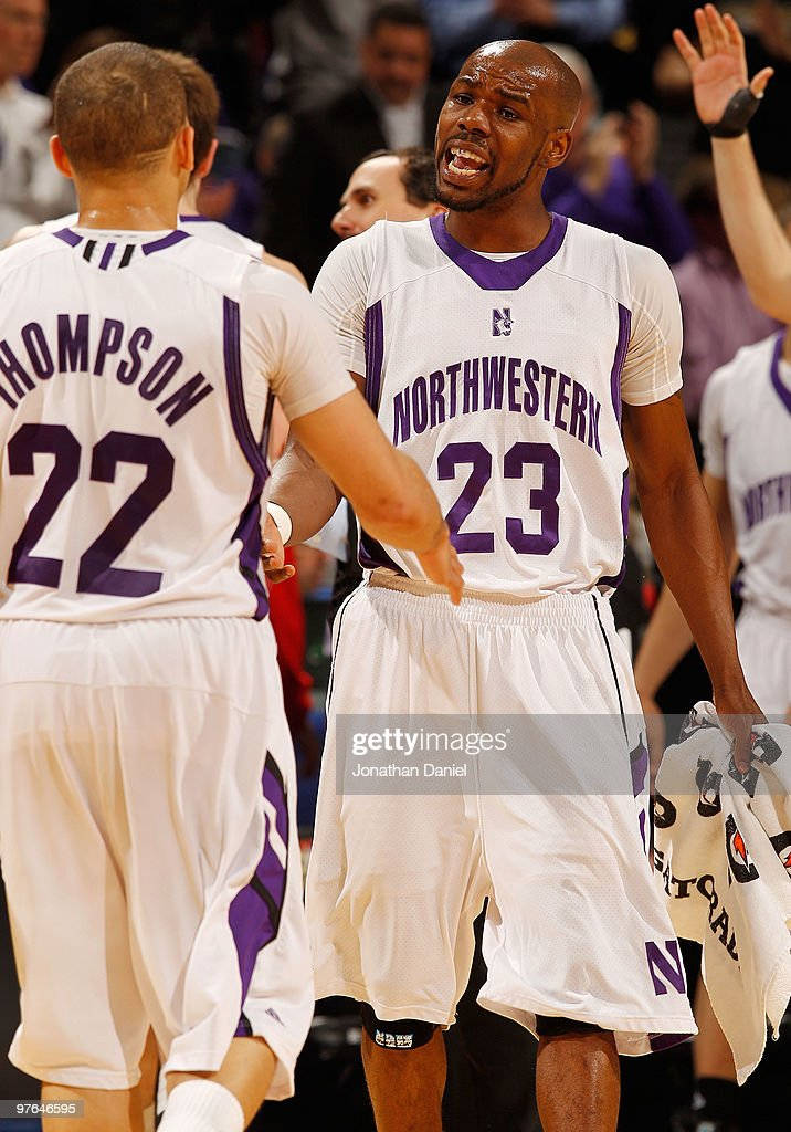 Guard Jeremy Nash #23 of the Northwestern Wildcats celebrates a play with guard Michael Thompson #22 during the game against the Indiana Hoosiers in the first round of the Big Ten Men's Basketball Tournament at Conseco Fieldhouse on March 11, 2010 in Indianapolis, Indiana.