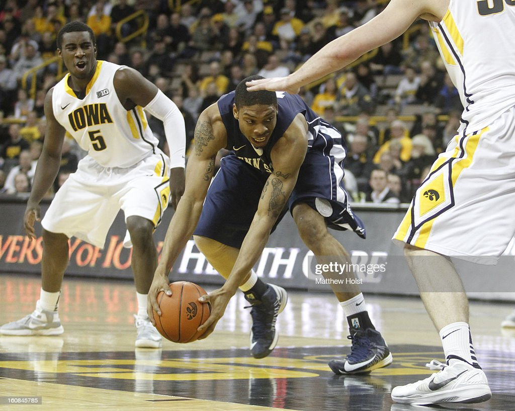 Guard Jermaine Marshall #11 of the Penn State Nittany Lions drives to the basket during the first half in front of guard Anthony Clemmons #5 of the Iowa Hawkeyes on January 31, 2013 at Carver-Hawkeye Arena in Iowa City, Iowa. Iowa won 76-67.