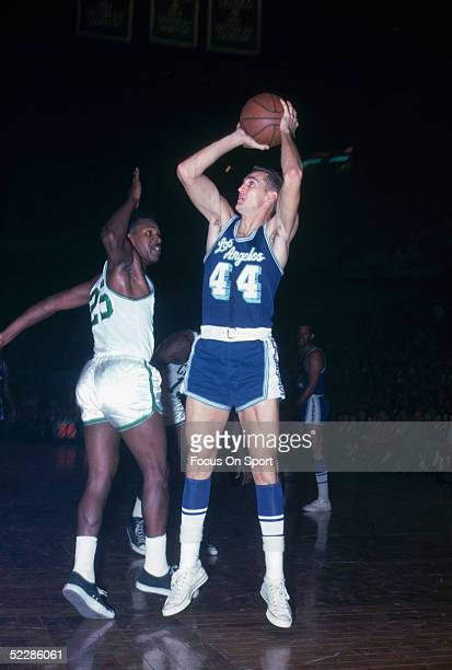Guard Jerry West of the Los Angeles Lakers shoots a jump shot as KC Jones of the Boston Celtics tries for the block during a game at the Boston...
