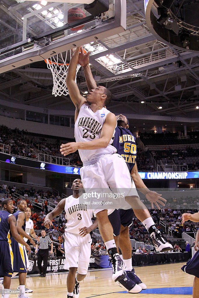 Guard John Jenkins of the Vanderbilt Commodores goes up for a shot as center Georges Fotso of the Murray State Racers defends during the first round...