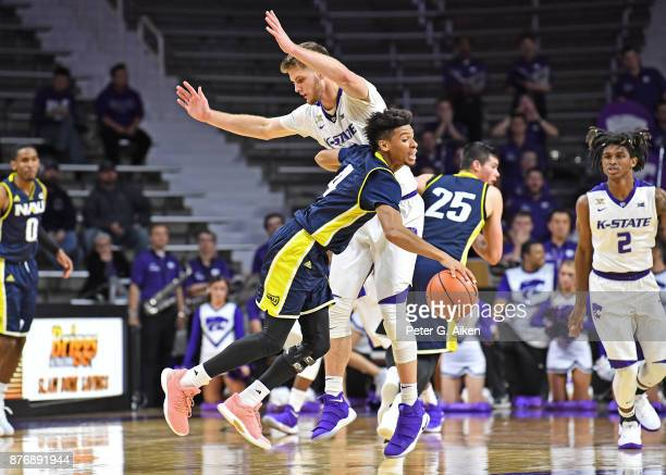 Guard JoJo Anderson of the Northern Arizona Lumberjacks drives into pressure from forward Dean Wade of the Kansas State Wildcats during the second...