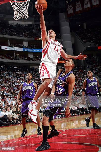 Guard Jon Barry of the Houston Rockets moves the ball past Kevin Martin of the Sacramento Kings on November 2 2005 at the Toyota Center in Houston...