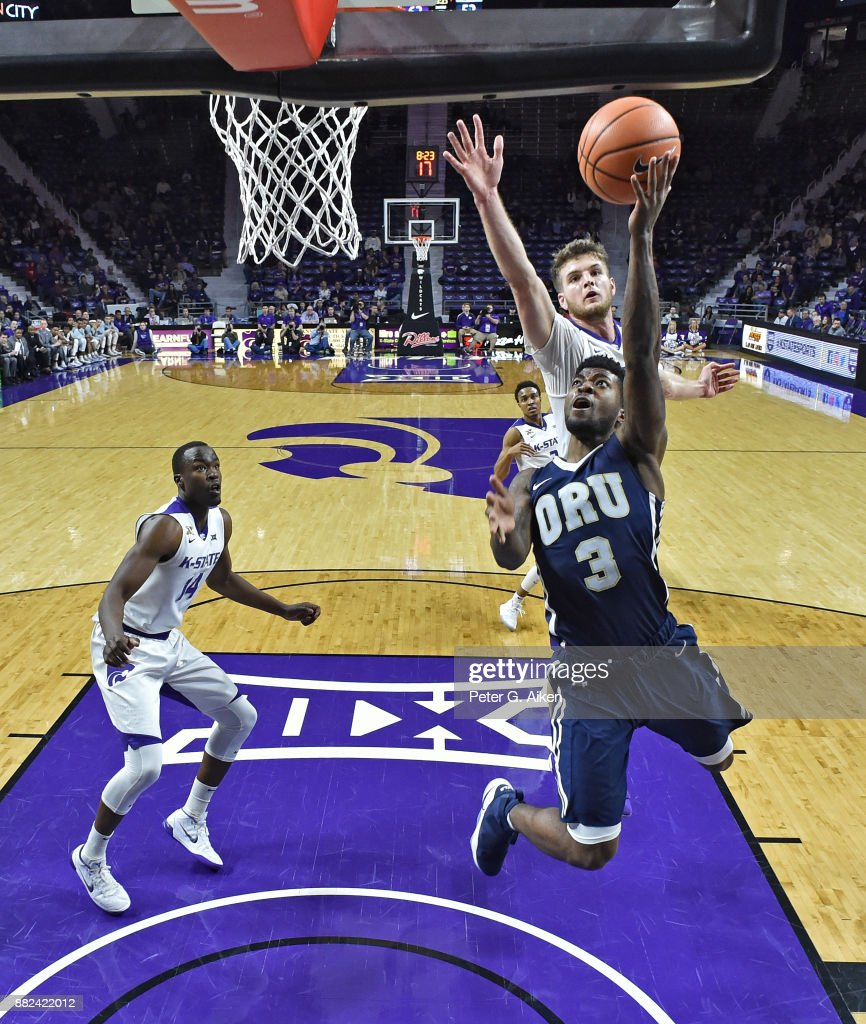 Guard Jontray Harris #3 of the Oral Roberts Golden Eagles drives to the basket past forward Dean Wade #32 of the Kansas State Wildcats during the second half on November 29, 2017 at Bramlage Coliseum in Manhattan, Kansas.