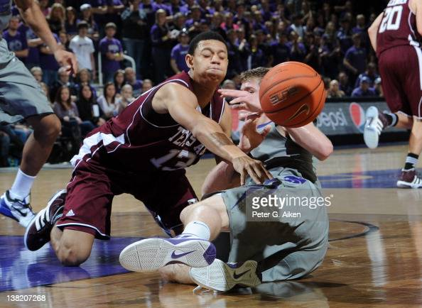 Guard Jordan Green of the Texas AM Aggies slaps the ball away from guard Will Spradling of the Kansas State Wildcats during the first half on...