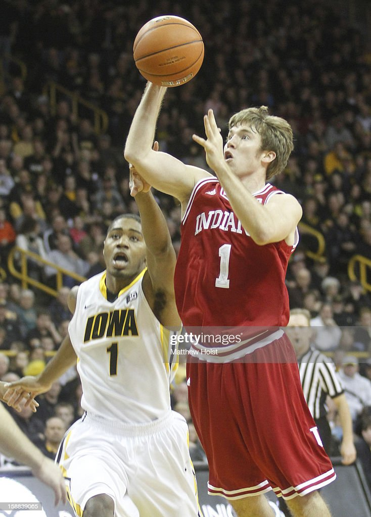 Guard Jordan Hulls #1 of the Indiana Hoosiers drives to the basket during the first half against forward Melsahn Basabe #1 of the Iowa Hawkeyes on December 31, 2012 at Carver-Hawkeye Arena in Iowa City, Iowa. Indiana won 69-65.
