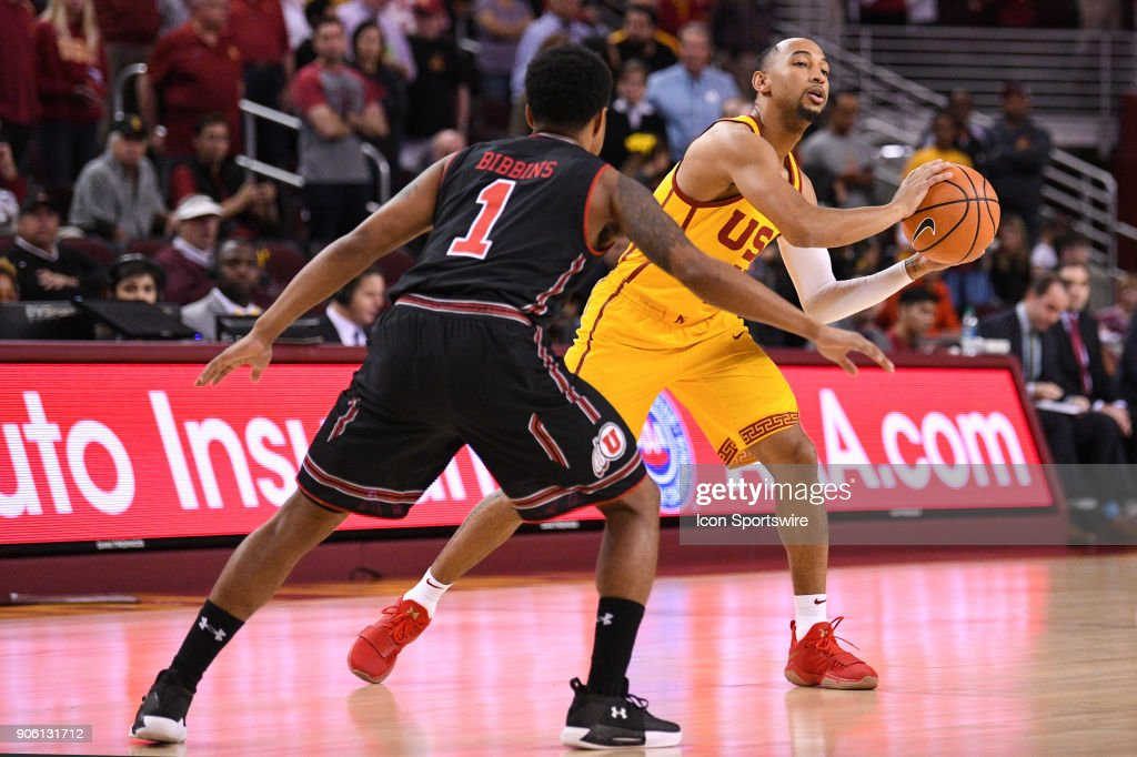 USC guard Jordan McLaughlin (11) looks to make a pass by Utah guard Justin Bibbins (1) during a college basketball game between the Utah Utes and the USC Trojans on January 14, 2018, at the Galen Center in Los Angeles, CA.
