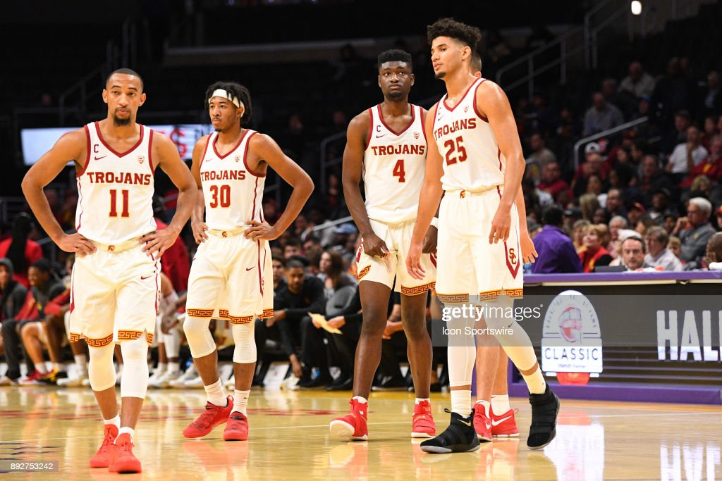USC guard Jordan McLaughlin (11), USC guard Elijah Stewart (30), USC forward Chimezie Metu (4) and USC forward Bennie Boatwright (25) look on during an college basketball game between the Oklahoma Sooners and the USC Trojans in the Basketball Hall of Fame Classic on December 8, 2017 at STAPLES Center in Los Angeles, CA.