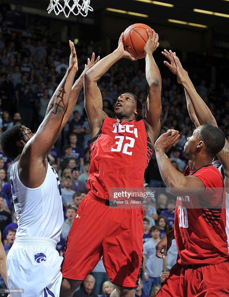Guard Jordan Tolbert #32 of the Texas Tech Red Raiders puts up a shot against forward Thomas Gipson #42 of the Kansas State Wildcats during the first half on February 25, 2013 at Bramlage Coliseum in Manhattan, Kansas. Kansas State defeated Texas Tech 75-55.