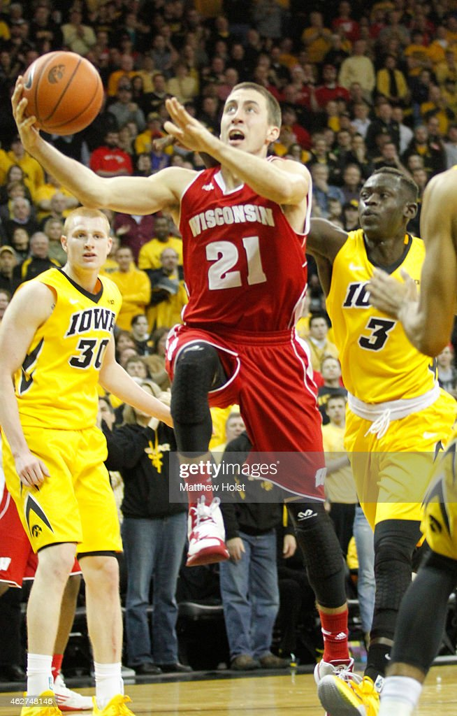 Guard <a gi-track='captionPersonalityLinkClicked' href=/galleries/search?phrase=Josh+Gasser&family=editorial&specificpeople=7355332 ng-click='$event.stopPropagation()'>Josh Gasser</a> #21 of the Wisconsin Badgers goes to the basket in front of guard Peter Jok #3 and forward <a gi-track='captionPersonalityLinkClicked' href=/galleries/search?phrase=Aaron+White+-+Basketball+Player&family=editorial&specificpeople=14619648 ng-click='$event.stopPropagation()'>Aaron White</a> #30 of the Iowa Hawkeyes, in the first half on January 31, 2015 at Carver-Hawkeye Arena, in Iowa City, Iowa.