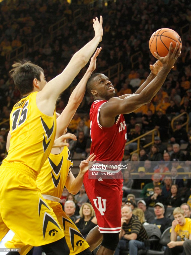 Guard Josh Newkirk #2 of the Indiana Hoosiers goes to the basket during the second half against forward Ryan Kriener #15 and guard Jordan Bohannon #3 of the Iowa Hawkeyes on February 17, 2018 at Carver-Hawkeye Arena, in Iowa City, Iowa.