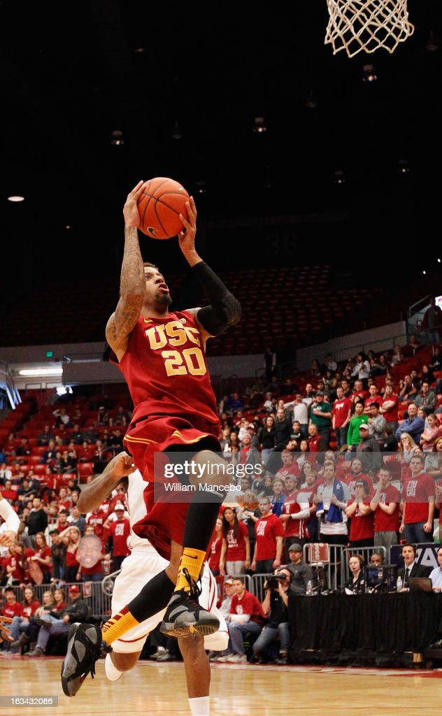 Guard J.T. Terrell #20 of the USC Trojans makes a goal attempt during the second half of the game against the Washington State Cougars at Beasley Coliseum on March 9, 2013 in Pullman, Washington.