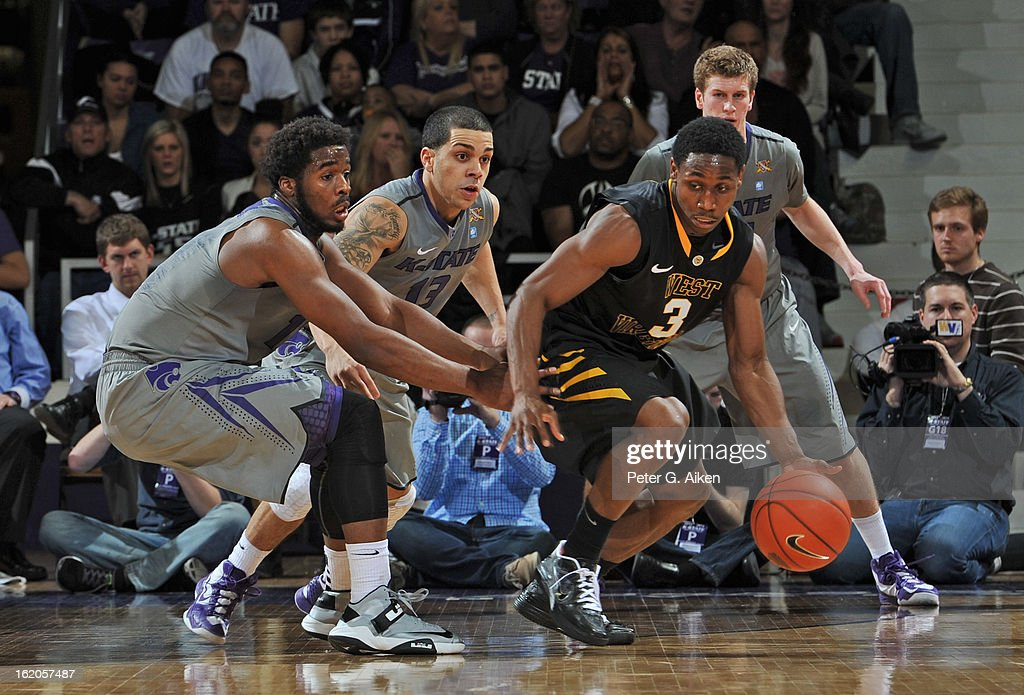 Guard Juwan Staten #3 of the West Virginia Mountaineers works against pressure from guard Nino Williams #11 of the Kansas State Wildcats during the second half on February 18, 2013 at Bramlage Coliseum in Manhattan, Kansas. Kansas State defeated West Virginia 71-61.