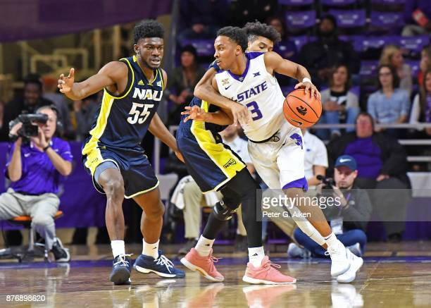 Guard Kamau Stokes of the Kansas State Wildcats drive with the ball against pressure form defenders JoJo Anderson and Ruben Fuamba of the Northern...
