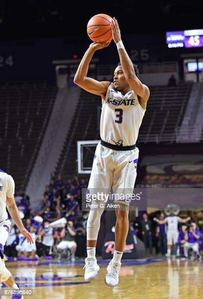 Guard Kamau Stokes of the Kansas State Wildcats shoots and scores a threepointer against the Northern Arizona Lumberjacks during the second half on...