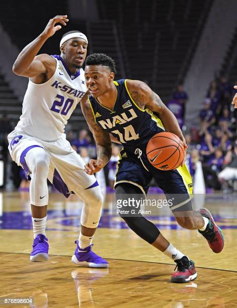 Guard Karl Harris of the Northern Arizona Lumberjacks drives to the basket against forward Xavier Sneed of the Kansas State Wildcats during the first...