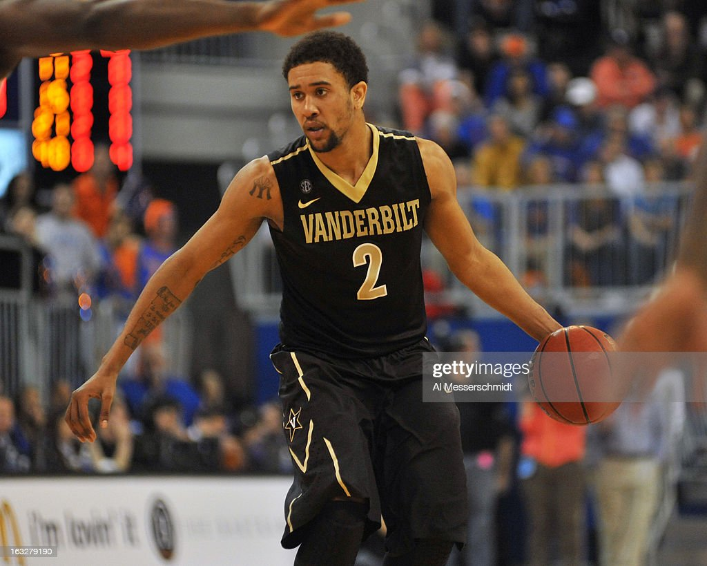 Guard Kedren Johnson #2 of the Vanderbilt Commodores controls the ball against the Florida Gators March 6, 2013 at Stephen C. O'Connell Center in Gainesville, Florida.
