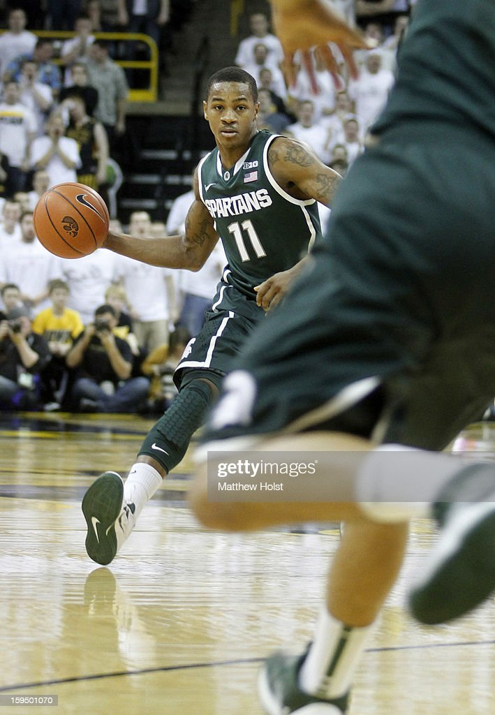 Guard Keith Appling #11 of the Michigan State Spartans brings the ball down the court during the first half against of the Iowa Hawkeyes on January 10, 2013 at Carver-Hawkeye Arena in Iowa City, Iowa. Michigan State won 62-59.