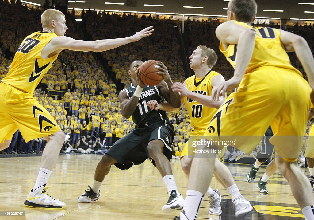 Guard <a gi-track='captionPersonalityLinkClicked' href=/galleries/search?phrase=Keith+Appling&family=editorial&specificpeople=7367720 ng-click='$event.stopPropagation()'>Keith Appling</a> #11 of the Michigan State Spartans drives to the basket during the first half between guard Mike Gesell #10 and forward <a gi-track='captionPersonalityLinkClicked' href=/galleries/search?phrase=Aaron+White+-+Basketball+Player&family=editorial&specificpeople=14619648 ng-click='$event.stopPropagation()'>Aaron White</a> #30 of the Iowa Hawkeyes on January 28, 2014 at Carver-Hawkeye Arena, in Iowa City, Iowa.