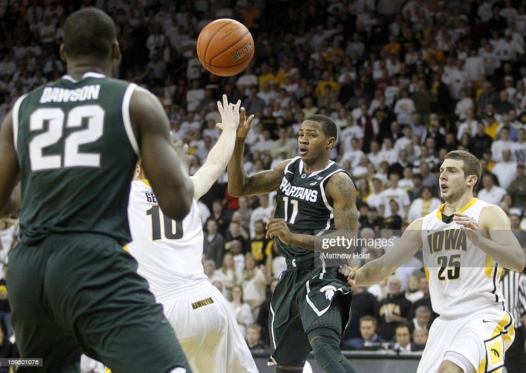 Guard Keith Appling #11 of the Michigan State Spartans passes to guard Branden Dawson #22 during the second half in front of guard Mike Gesell #10 of the Iowa Hawkeyes on January 10, 2013 at Carver-Hawkeye Arena in Iowa City, Iowa. Michigan State won 62-59.