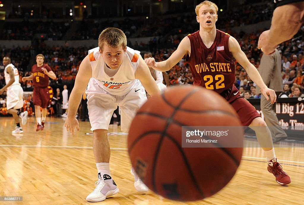 Guard Keiton Page #12 of the Oklahoma State Cowboys watches the ball fall out of bounds with Bryan Petersen #22 of the Iowa State Cyclones during the Phillips 66 Big 12 Men's Basketball Championship at the Ford Center March 11, 2009 in Oklahoma City, Oklahoma.