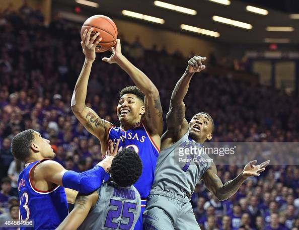 Guard Kelly Oubre Jr #12 of the Kansas Jayhawks pulls down a rebound against guard Jevon Thomas of the Kansas State Wildcats during the first half on...