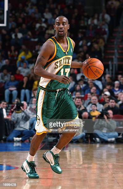 Guard Kenny Anderson of the Seattle Sonics eyes the floor as he dribbles against the Philadelphia 76ers during the game at First Union Center on...