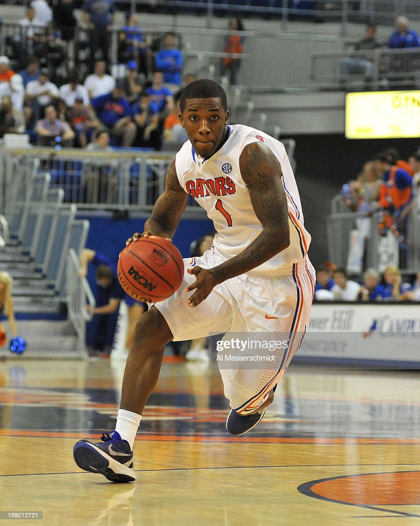 Guard Kenny Boynton #1 of the Florida Gators drives up court against the Georgia Bulldogs January 9, 2013 at Stephen C. O'Connell Center in Gainesville, Florida. The Gators won 77 - 44.
