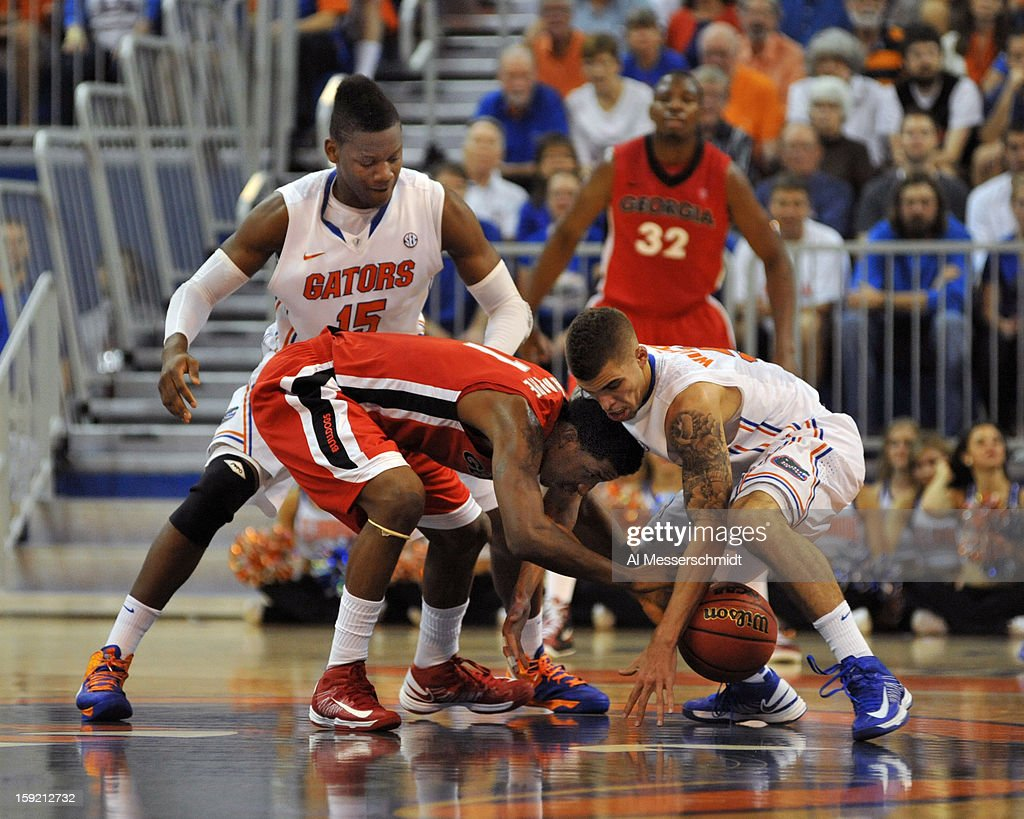 Guard Kentavious Caldwell-Pope #1 of the Georgia Bulldogs and guard Scottie Wilbekin #5 of the Florida Gators battle for a loose ball January 9, 2013 at Stephen C. O'Connell Center in Gainesville, Florida. The Gators won 77 - 44.