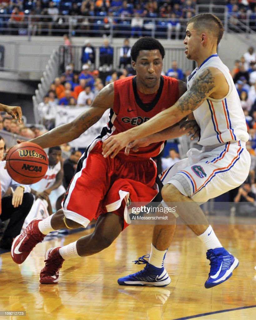 Guard Kentavious Caldwell-Pope #1 of the Georgia Bulldogs drives on guard Scottie Wilbekin #5 of the Florida Gators January 9, 2013 at Stephen C. O'Connell Center in Gainesville, Florida. The Gators won 77 - 44.