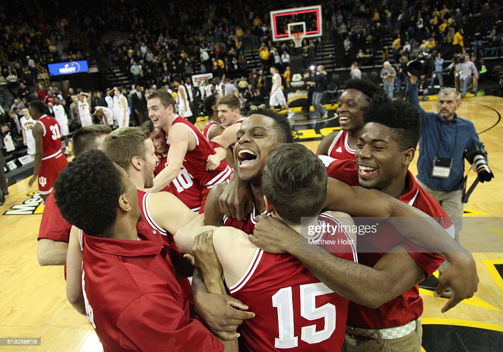 Guard Kevin 'Yogi' Ferrell of the Indiana Hoosiers celebrates with teammates after they defeated the Iowa Hawkeyes to win the Big10 title on March 1...