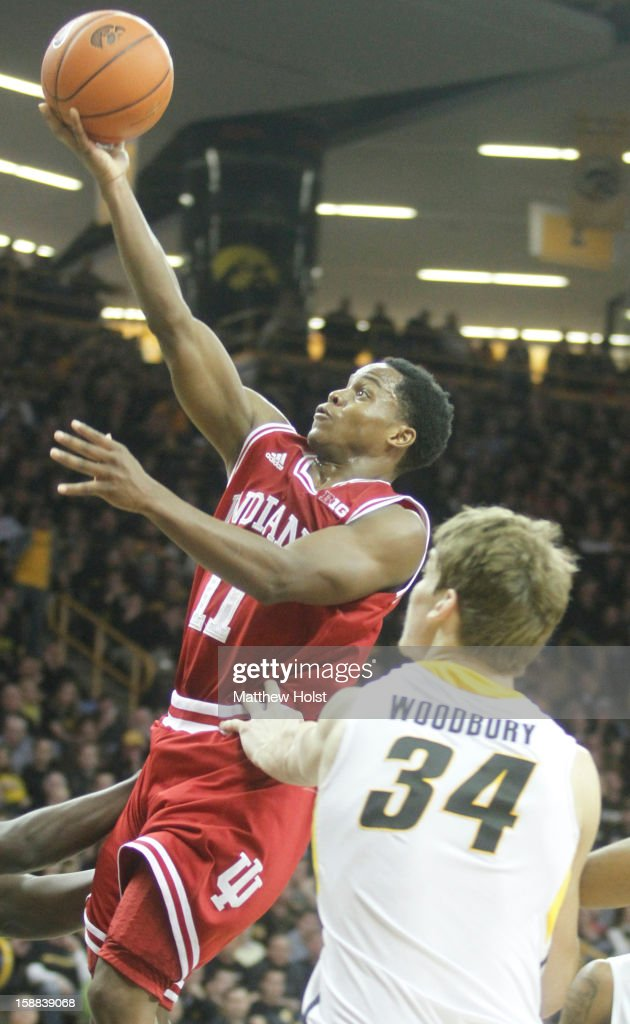 Guard Kevin 'Yogi' Ferrell of the Indiana Hoosiers drives to the basket during the first half against center Adam Woodbury #34 of the Iowa Hawkeyes on December 31, 2012 at Carver-Hawkeye Arena in Iowa City, Iowa. Indiana won 69-65.