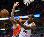 Guard Khris Middleton of the Milwaukee Bucks passes the ball against the Chicago Bulls in the second quarter of game three of the first round of the...