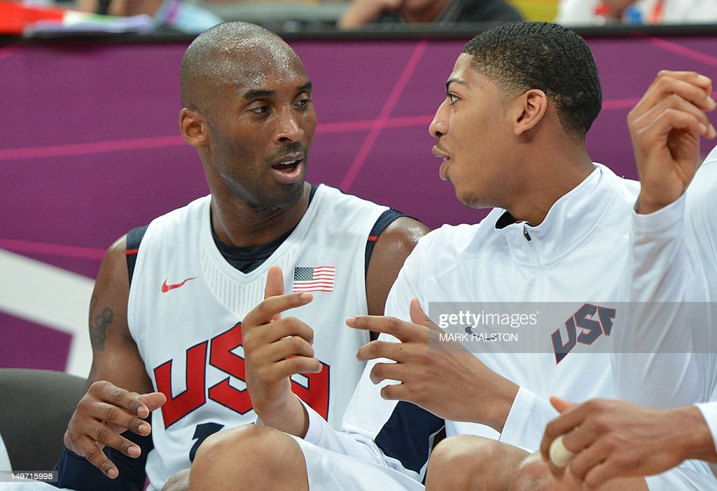 US guard Kobe Bryant chats with US centre Anthony Davis during the men's preliminary round basketball match USA vs Nigeria of the London 2012 Olympic...
