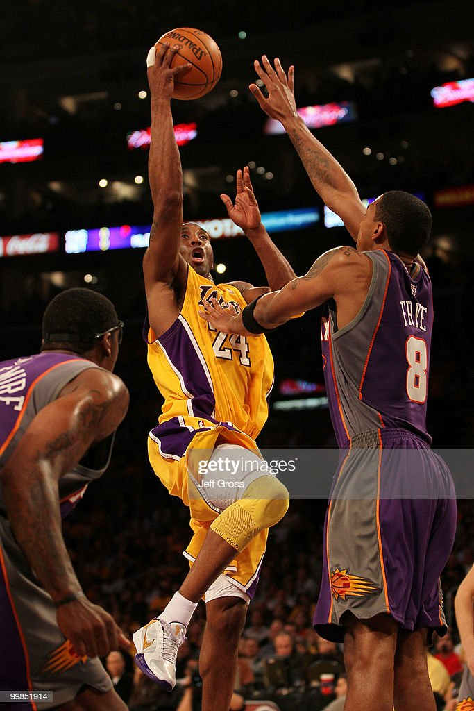 Guard Kobe Bryant #24 of the Los Angeles Lakers goes up for a shot against Channing Frye #8 of the Phoenix Suns in Game One of the Western Conference Finals during the 2010 NBA Playoffs at Staples Center on May 17, 2010 in Los Angeles, California.